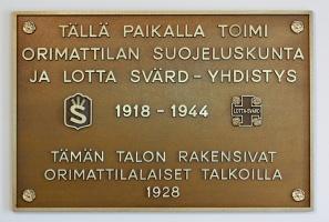 kuva 104065 . Jymylinna, Orimattila: Tällä paikalla toimi Orimattilan suojeluskunta ja Lotta Svärd -yhdistys 1918-1944. Tämän talon rakensivat orimattilalaiset talkoilla 1928. . 14.9.2008